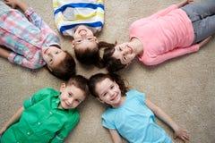 Happy smiling little children lying on floor Stock Photo