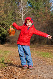 Happy smiling little girl in the autumn forest. Royalty Free Stock Images