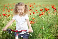 Happy smiling little girl with bicycle Royalty Free Stock Photos
