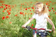 Happy smiling little girl with bicycle stock image