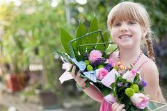 Happy smiling little girl with a bouquet of flowers Stock Photography