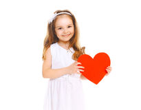 Happy smiling little girl child with big red paper heart on white royalty free stock photos
