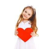 Happy smiling little girl child with big red paper heart on white Stock Images