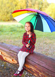 Happy smiling little girl child with colorful umbrella in autumn Royalty Free Stock Photo