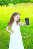Happy smiling little girl child making self portrait on smartphone Royalty Free Stock Photo