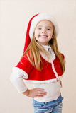Happy smiling little girl in christmas hat Stock Image