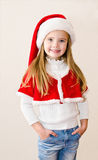 Happy smiling little girl in christmas hat Royalty Free Stock Photography