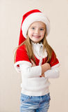 Happy smiling little girl in christmas hat Royalty Free Stock Photo
