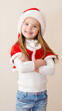 Happy smiling little girl in christmas hat Stock Photo