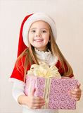 Happy smiling little girl with christmas present Stock Image