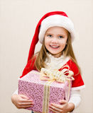 Happy smiling little girl with christmas present Stock Images