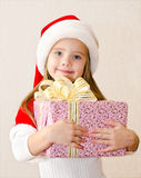 Happy smiling little girl with christmas present Royalty Free Stock Images