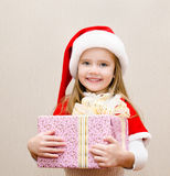 Happy smiling little girl with christmas present Royalty Free Stock Photos