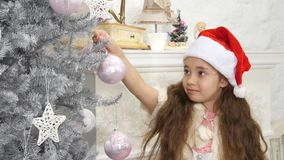 Happy smiling little girl decorated new year tree stock video