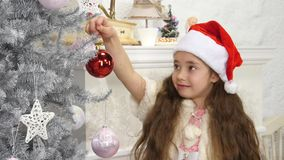 Happy smiling little girl decorated new year tree stock video footage