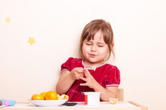 Happy smiling little girl eating fruits and yogurt Stock Photos