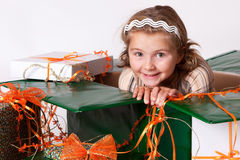 Happy smiling little girl between gifts Stock Image