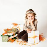 Happy smiling little girl between gifts Stock Photo