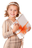 Happy smiling little girl holding a gift Royalty Free Stock Image