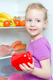 Happy smiling little girl holding paprika Stock Image