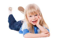 Happy smiling little girl lie Stock Photography