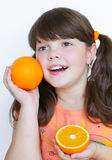 Happy smiling little girl with orange, joy Stock Photo