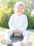 Happy smiling little girl outdoors Stock Photo