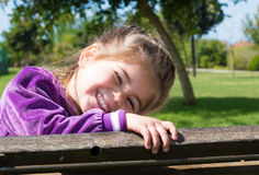 Happy smiling little girl outdoors Royalty Free Stock Images