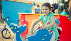 Happy smiling little girl on playground Stock Photography