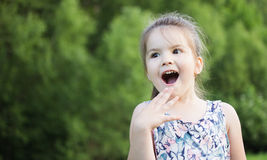 Happy smiling little girl on playground Stock Photos