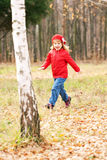 Happy smiling little girl running in forest Royalty Free Stock Photo