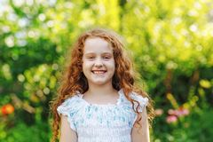 Little girl show white teeth. Royalty Free Stock Image