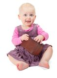 Happy smiling little girl in violet dress sits Royalty Free Stock Photography