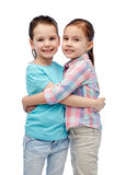 Happy smiling little girls hugging Royalty Free Stock Photos