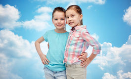 Happy smiling little girls hugging Royalty Free Stock Photo