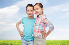 Happy smiling little girls hugging Stock Photo