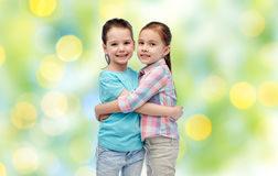 Happy smiling little girls hugging Royalty Free Stock Images