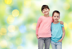 Happy smiling little girls hugging Royalty Free Stock Image