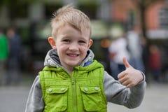 Happy smiling little stylish blonde boy show ok sign Royalty Free Stock Images