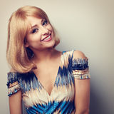 Happy smiling makeup woman with blond short hair style looking. Closeup toned portrait Stock Photos