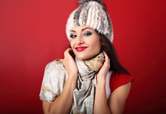 Happy smiling makeup woman in white fur winter hat and fashion s Stock Photo