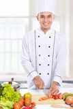 Male chef preparing some food Royalty Free Stock Photos