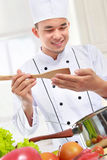 Professional male chef cooking Stock Images