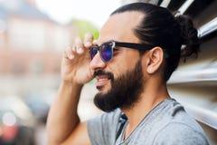 Happy smiling man with beard on city street Stock Photos