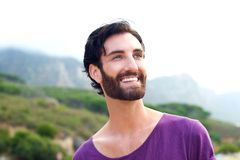Happy smiling man with beard standing in outdoors in nature Stock Photos
