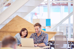 Happy smiling man busy working with his female partner royalty free stock photo