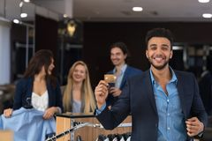 Happy Smiling Man With Credit Card In Clothes Shop. Young Businessman Pay For Purchase Royalty Free Stock Photos