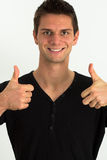 Happy smiling man doing two thumbs up. Happy smiling man in a black t-shirt doing two thumbs up Royalty Free Stock Image