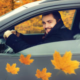 Happy smiling man driver behind the wheel of his car Royalty Free Stock Photography
