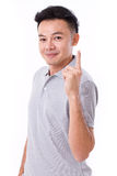 Happy, smiling man giving no.1 hand gesture Stock Photo